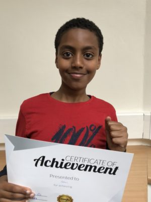 John proudly holding his new Reward! Great work and deserved progress with his tutor at Genie Tutors King's Heath!